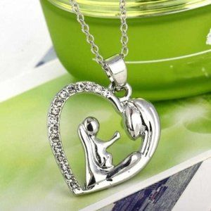 Silver tone mother child heart necklace NWT